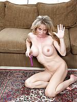Sexy mom next door fucks her pussy with purple dildo