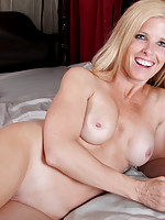 Sweet blonde mom in her hot sheer lingerie peels off her thong and fucks a spiral toy