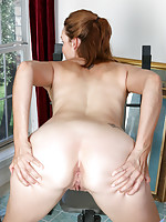 Stunning MILF bends over and teases her dripping wet pussy